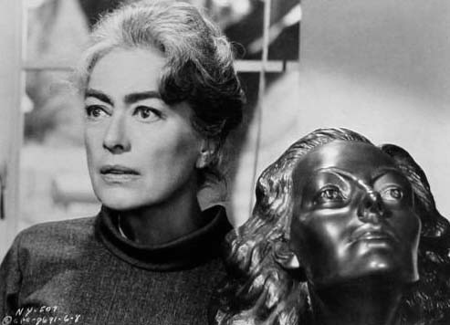 With the same sculpture in 1964's 'Strait-Jacket.'