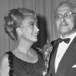 At the 4/5/65 Oscars with Best Director George Cukor. (Joan presented him with his award during the show.) Thanks to Bryan Johnson.