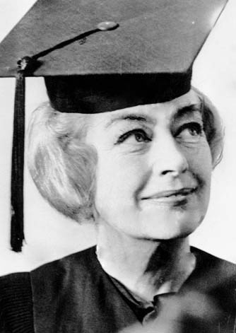 1966. Joan receives an honorary Associate of Arts degree in Newport, RI, from Vermont Jr. Court College. (Thanks to Bryan Johnson.)