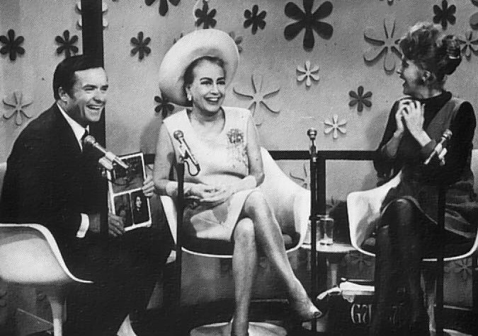 September 1968 on 'The Mike Douglas Show.' Douglas is holding the just-released 'Films of Joan Crawford' book.