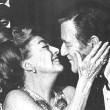 Joan receives the Cecil B. DeMille Award from John Wayne at the Golden Globes. 2/3/70.