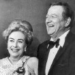 Golden Globes, 2/3/70. With John Wayne after he presented her with the Cecil B. DeMille Award.