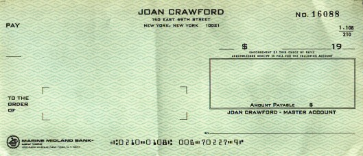 A personal check from Joan's last address on E. 69th St.