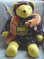 Joan Pawford as 'Mommie Bearest' from the North American Bear VIB series. Note the hanger earrings! (Not wire!)
