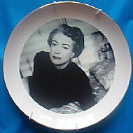 A plate, 8 inches in diameter, with 24k gold rim. EBay auction 9/04, with the description: 'Will look great on your Bitch of a Bearing Wall!'