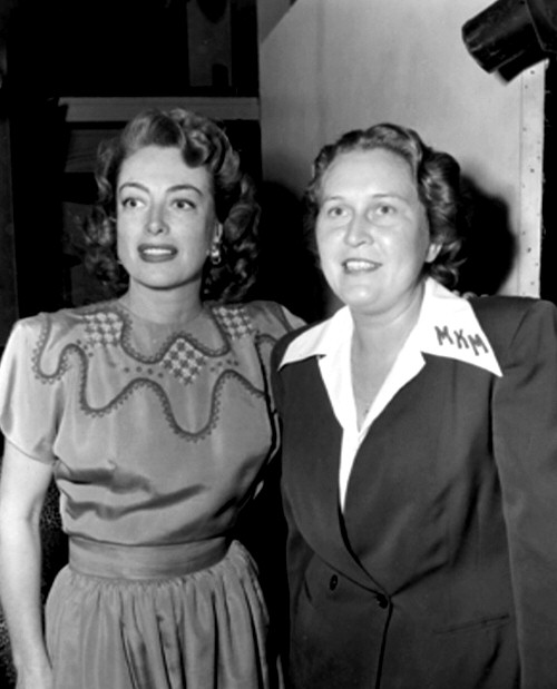 1947. On the set of 'Daisy Kenyon' with a fan-club member.