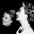 May 1963. Joan delivers Oscar to Anne Bancroft on the set of Bancroft's Broadway show, 'Mother Courage and Her Children.'