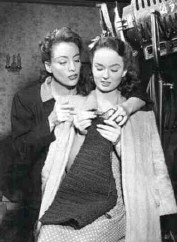 Joan helps Ann with her knitting on the set of 'Mildred Pierce.'