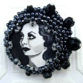 A beaded Joan brooch by Sherri Leeder.