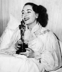 Joan and Oscar greet reporters from her sick-bed following the announcement of her Best Actress win for 'Mildred Pierce.' 3/7/46.
