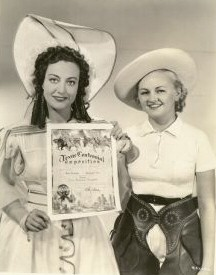 1936. On the set of 'Hussy' with a Texas Rangerette.