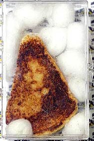 This is the toast that sold on eBay in Nov. '04 for $28,000. The woman's face in the toast was alleged to be the Virgin Mary's. However, in Feb. '05, the LA Times Online made a claim that the face was, indeed, Joan Crawford's!