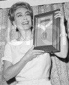 Joan picks up her '65 USO award. Source: CORBIS