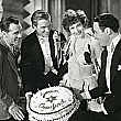 Joan celebrates her birthday on the set of 'Our Modern Maidens.' With director Jack Conway, husband Doug, co-star Rod LaRocque.