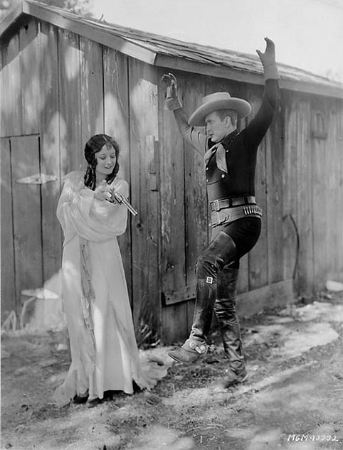 1928, 'Law of the Range,' with Tim McCoy.