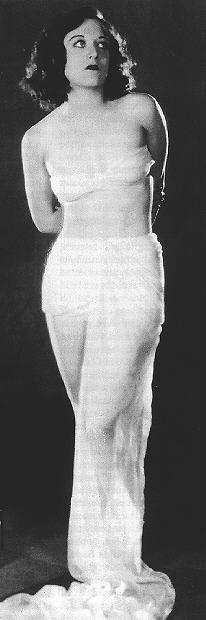 1928, by Ruth Harriet Louise. Joan as Venus de Milo.