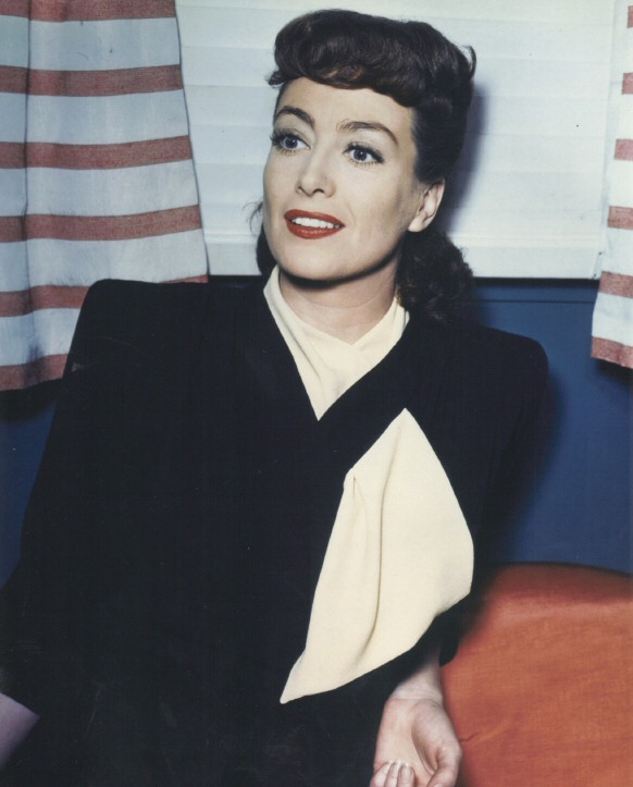 1945. On the set of 'Mildred Pierce.' (Thanks to Norman, who actually OWNS the outfit she's wearing!)