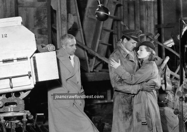 Director Howard Hawks, Gary Cooper, Joan on the set of 'Today We Live.'