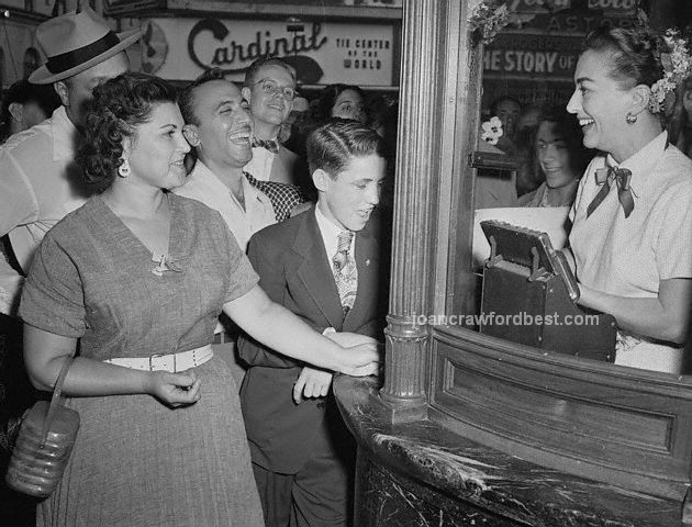 August 7, 1952. Joan takes tickets at the 'Sudden Fear' premiere.
