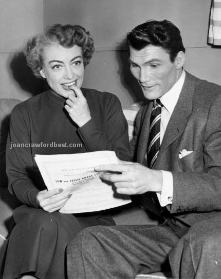 1952. On the set of 'Sudden Fear' with co-star Jack Palance.