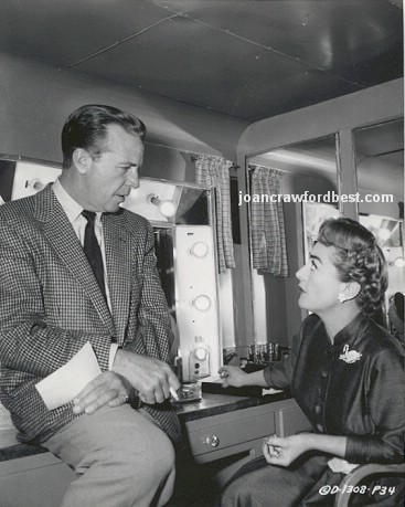1955. With Dick Powell.