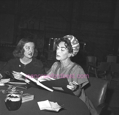 1962. Signing contracts for 'Baby Jane.'