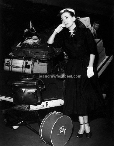 8/2/52. Joan and luggage at Grand Central Station.