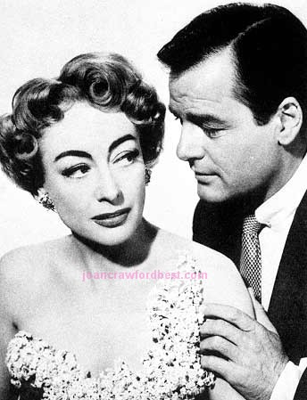 1953. Publicity shot for 'Torch Song,' with Gig Young.