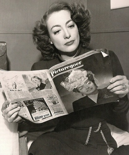 1946. On the set of 'Humoresque' with a 2/6/46 'Picturegoer' featuring herself on the cover.