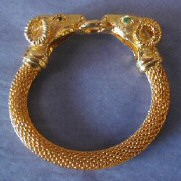 Joan's faux gold ram-headed bracelet. From the William Wilt collection.