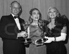 Joan at the '65 Emmys with Melvyn Douglas and Ginger Rogers. Source: CORBIS.