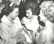 Shirley Eder, center, chats with a twin and Joan